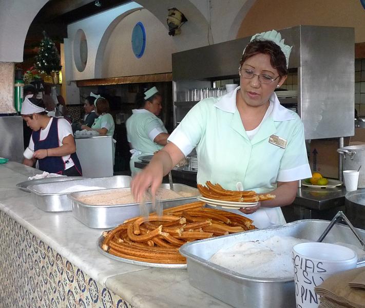 serving up churros at El Moro